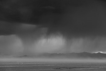 Storm clouds and a darkening sky over the  Bonneville Salt Flats.