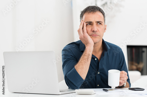 Unhappy Man At The Desk