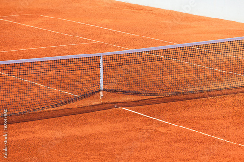 Empty Clay Tennis Court and Net