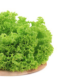 Fresh green salad on wooden board