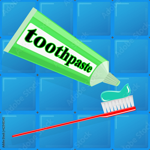 toothpaste and toothbrush on background of blue tiles
