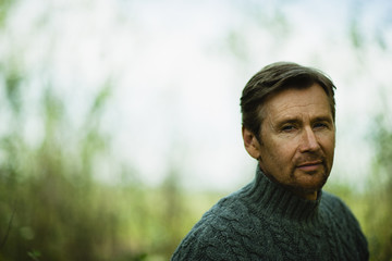 A middle-aged man looking pensive.