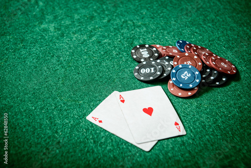 aces and chips on a green felt