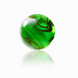 A green glass marble with an interior pattern.