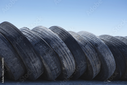 A row of discarded rubber tires.