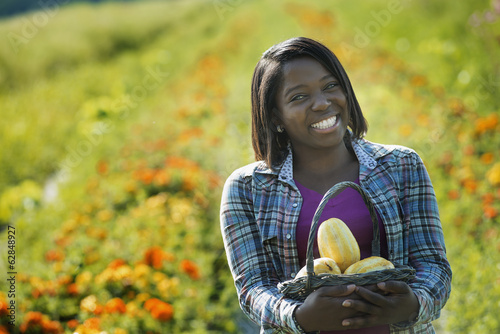 Woman Picking Vegetables at Organic Farm