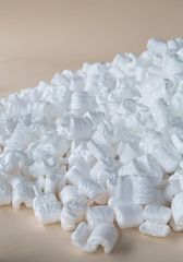 Heap of packaging shapes, white polystyrene material.