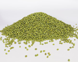 Mung beans, also known as green gram or golden gram, native to India. Heaped on a white background.
