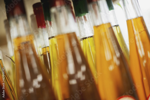 A farm stand. Bottles of vinegar.