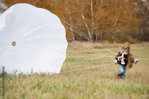 Young female pilot parachute
