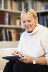 senior woman using touch pad device