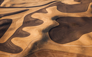 Farmland landscape, with ploughed fields and furrows in Palouse, Washington, USA. An aerial view with natural patterns.