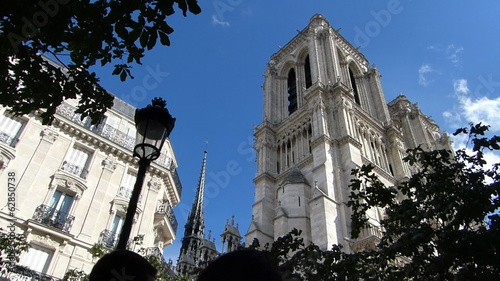 Notre Dame Cathedral in Paris France, people passing