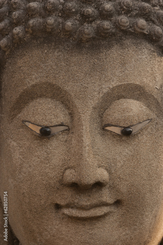 The face of a statue of the Buddha in Ayutthaya Historical Park, Thailand