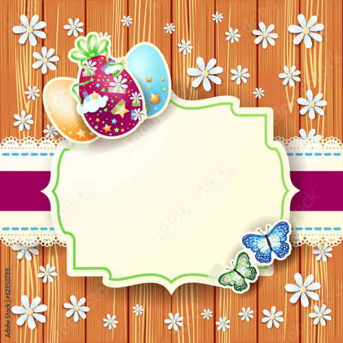 Easter card with eggs and label, on wooden background