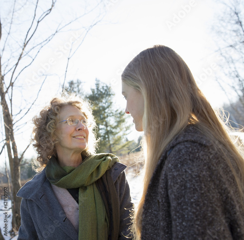 Two women outdoors wearing warm clothes against the cold. Mother and daughter.