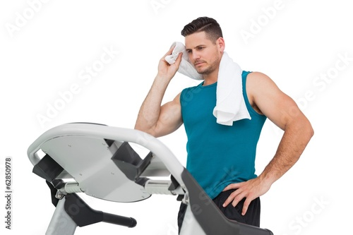 Young man running on a treadmill
