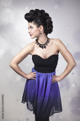 Woman with professional make-up and hairstyle. Fashion shot