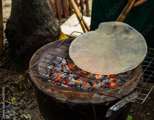 Indigenous rice cracker on stove