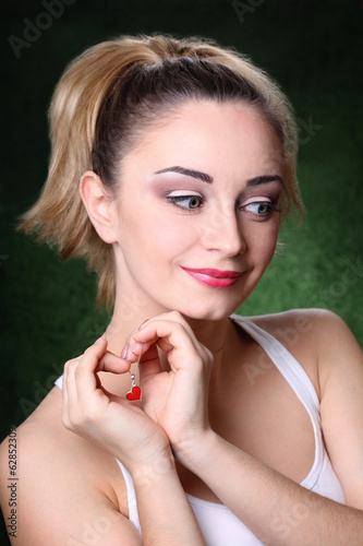 girl with a pendant in the shape of a heart