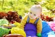 funny baby boy  in fall