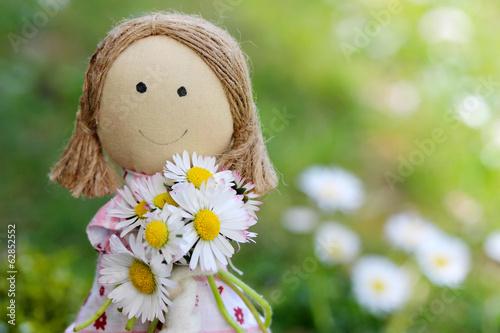 canvas print picture Stoffpuppe mit Blumen zum Muttertag