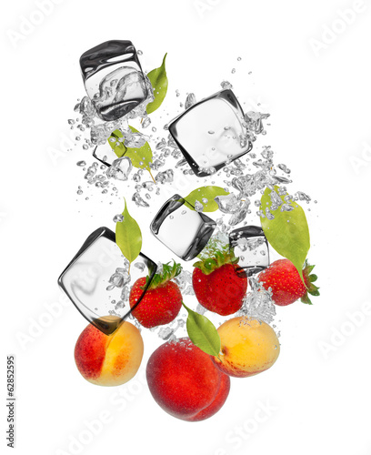 Fresh fruit falling in water splash