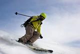 skier on mountain slopes