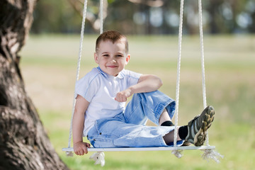 Child on a swing on a nature