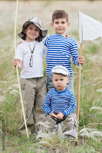 Children on walk on a meadow