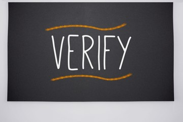 Verify written on big blackboard