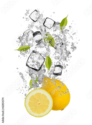 Fresh lemons falling in water splash