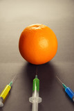 Healthy orange and three syringes with modification liquid poster