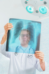 Doctor looks at x-ray image of lungs in a hospital