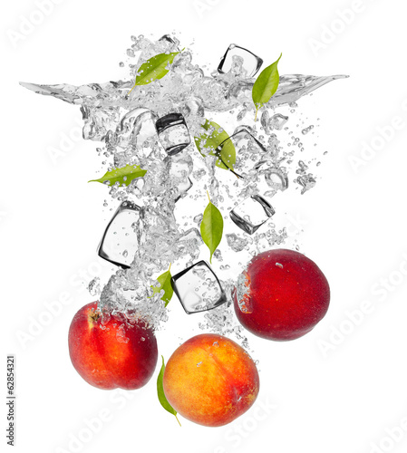Fresh nectarines falling in water splash