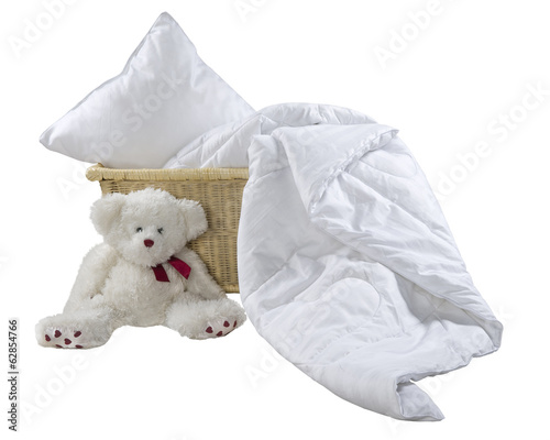 pillow and blanket in wicker basket - 62854766