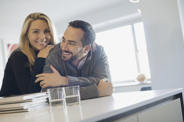 Couple at home in modern kitchen