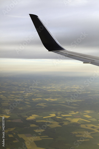 The winglet or wing tip of an aircraft viewed from the passenger window.