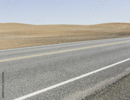 Road through ploughed farmland, near Pullman