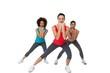 Full length portrait of women doing power fitness exercise