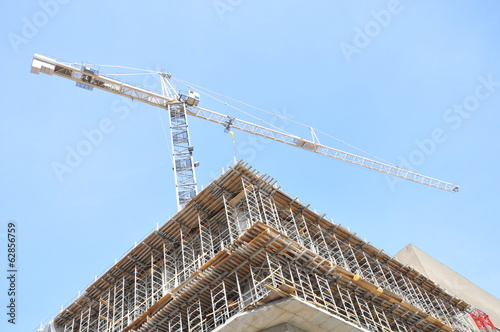 Crane above a building under construction