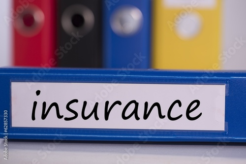 Insurance on blue business binder