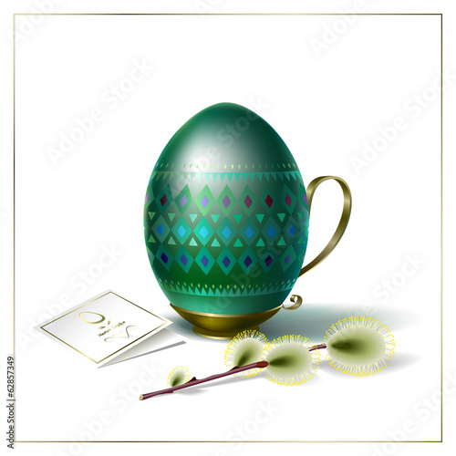 Easter egg with green ornament and sprig of willow