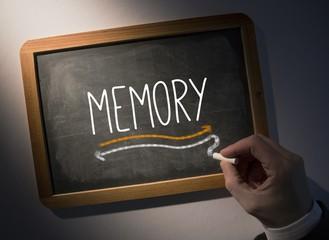 Hand writing Memory on chalkboard