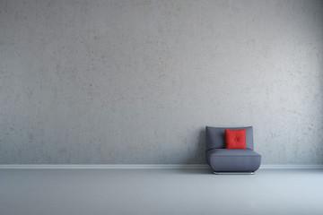 Sessel vor Wand aus Beton