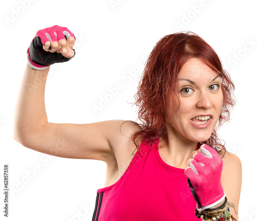 Cute young girl doing boxing over white background.