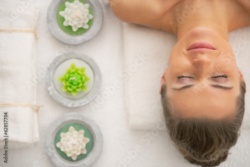 Portrait of young woman relaxing on spa
