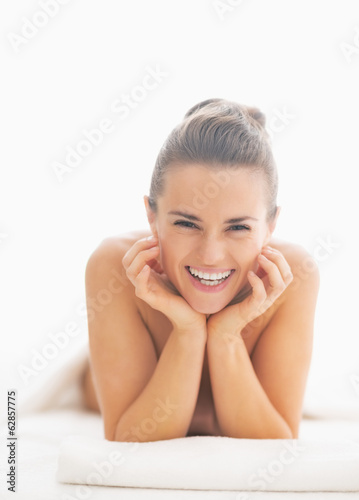 canvas print picture Portrait of smiling young woman on massage table
