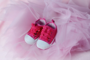 on pink tulle trim red baby shoes with big laces