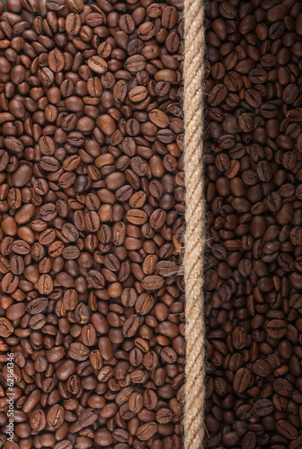 Illuminated and dark coffee beans and rope
